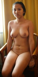 Naked Asian Teen Posing on The Chair