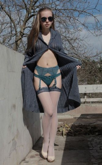 Sexy Teen In Knitted Sweater And Stockings Outdoors