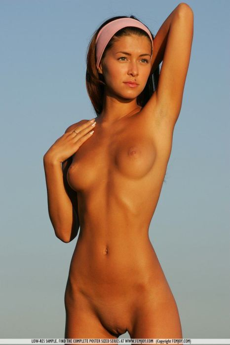 Tanned Bald Pussy On A Slender Nude Teen Outdoors