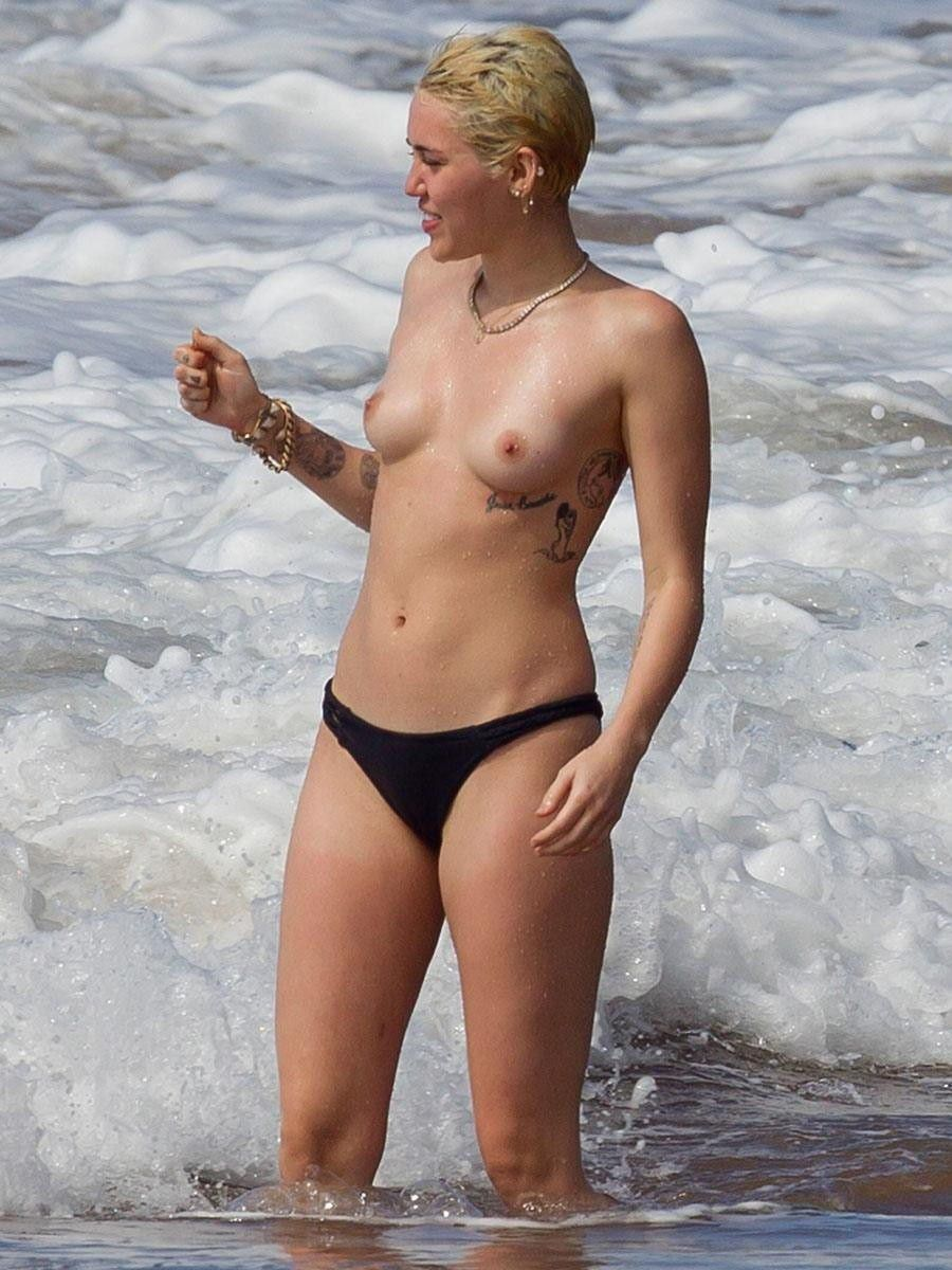 tube8 Miley Cyrus Bares Topless Breasts On Beach