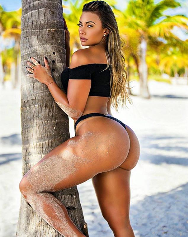 Villalba on the beach by palm tree
